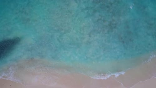 Wide above abstract shot of a white sandy paradise beach and blue ocean background in best quality 4