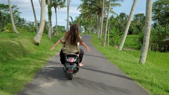 Thumbnail for Happy Couple Tripping By Motorcycle on Tropical Road at Sunset Time. Outdoor Shot of Young Couple