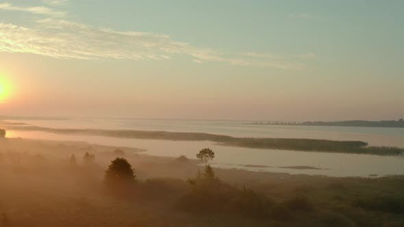 Aerial Drone View. Beautiful Misty Dawn in the Spring on the Lake. V2