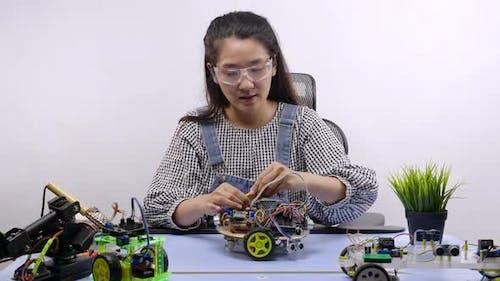 Robotics Engineer testing a robot. Innovative technology mechanical for Assistive Technology