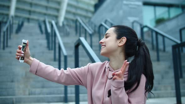 Thumbnail for Happy Woman Making Photo on Smartphone Outside. Sporty Woman Making Selfie Photo