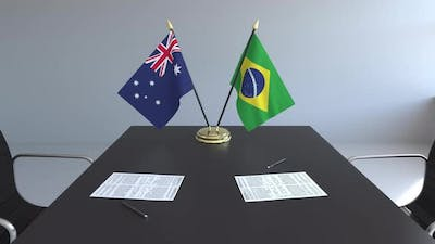 Flags of Australia and Brazil on the Table