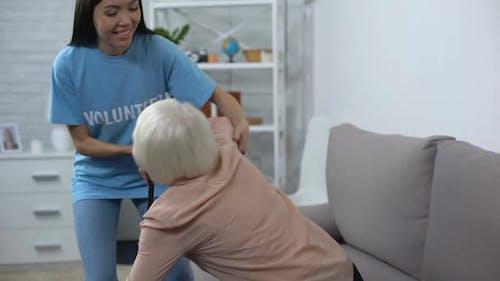 Kind Hospital Volunteer Helping Disabled Pensioner With Walking Stick, Altruism