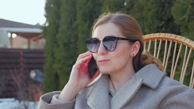 Woman In Sunglasses Talking On Phone