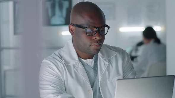 Modern Doctor Working On Laptop