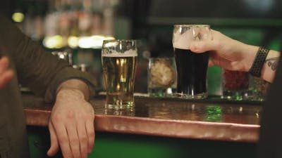 Unrecognizable Men With Beer At Bar