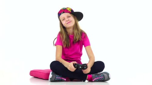 Teen with Console Playing Video Game, Slow Motion. White Background