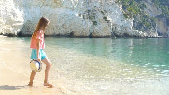 Thumbnail for Adorable Little Girl on the Seashore Alone
