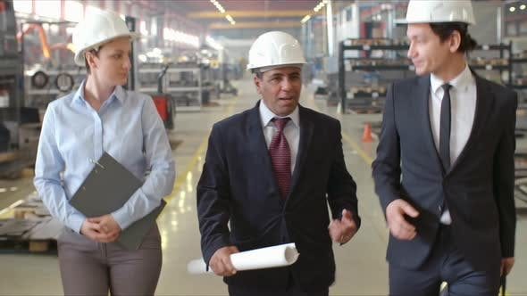 Thumbnail for Executive Engineer Talking to Employees while Walking in Factory