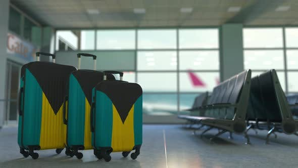 Thumbnail for Travel Suitcases with Flag of Bahamas in the Airport Terminal