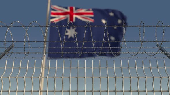 Thumbnail for Blurred Waving Flag of Australia Behind Barbed Wire Fence