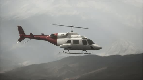 Thumbnail for Extreme Slow Motion Flying Helicopter Near Mountains with Fog