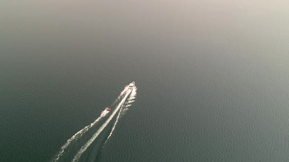 Thumbnail for Boat Pulling Inner Tubes Into Smoke From Forest Fire