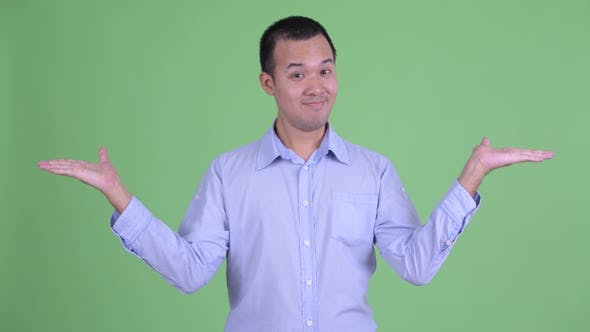 Thumbnail for Happy Asian Businessman Comparing Something