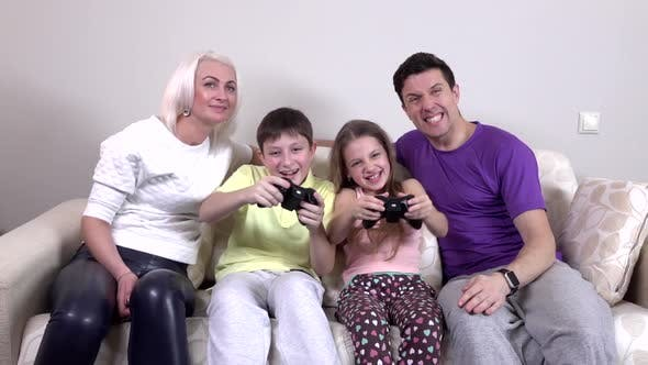 Thumbnail for Family Playing Video Games in the Living Room, Slowmotion