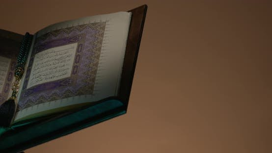 Thumbnail for Holy Quran On Book Rest At Left Side With Prayer Beads Rotation
