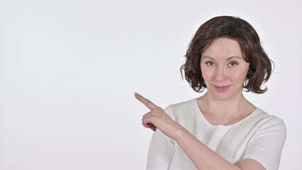 Thumbnail for Old Woman Pointing at Product on White Background