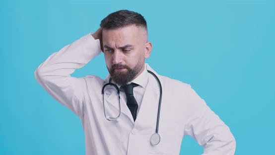 Thumbnail for Pensive Medical Doctor Thinking About Patient Diagnosis, Scratching Head, Blue Studio Background