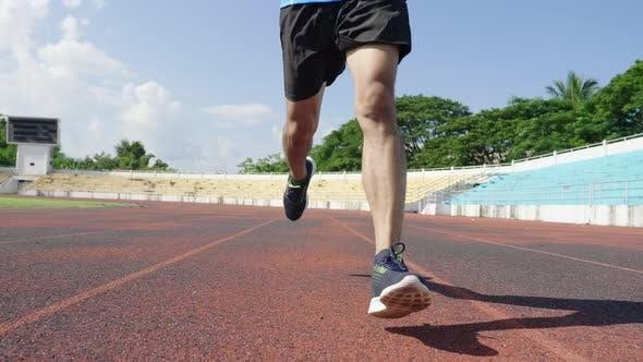 Runner's Legs Running At The Stadium