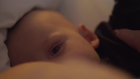 A Cute Closeup of a Breastfeeding Scene
