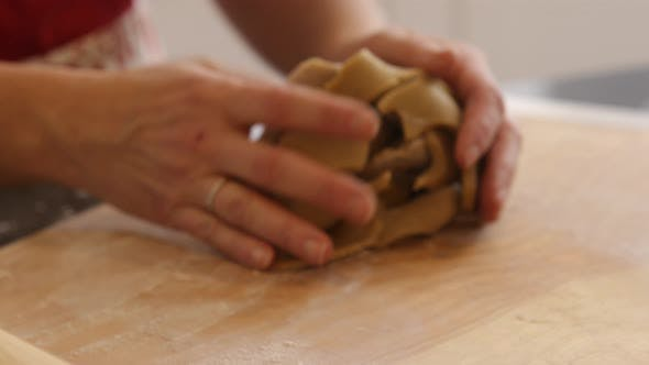 Using rolling pin to roll cookie dough