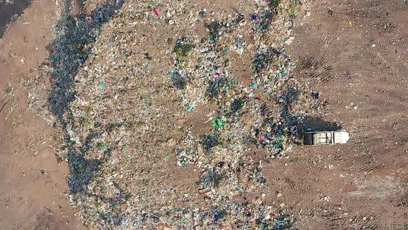 Thumbnail for The Bulldozer Compacts the Garbage on the Landfill. Wastes of Human Life. Aerial View