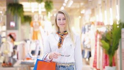 Woman Posing Against Fashion Store