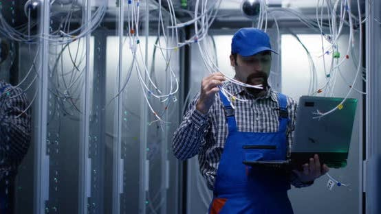 Thumbnail for Technician Checking Cables in a Data Center