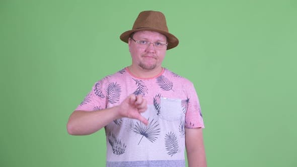 Thumbnail for Sad Overweight Bearded Tourist Man Giving Thumbs Down
