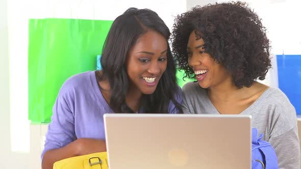 Thumbnail for Two African American friends using laptop computer together