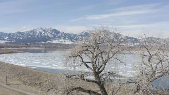Thumbnail for Fly Over Tree View Of Frozen Lake Boulder Colorado Sunny Day
