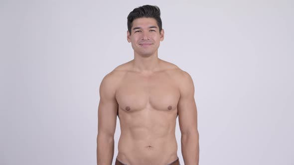 Thumbnail for Happy Young Handsome Muscular Shirtless Man with Arms Crossed