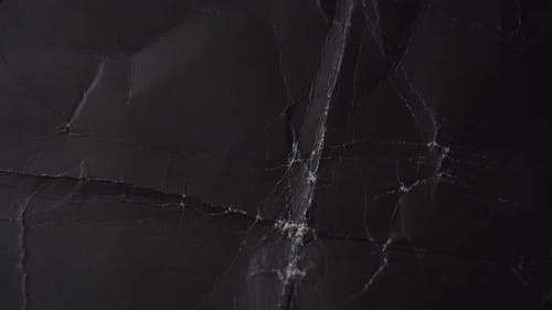 Old crumpled black paper.
