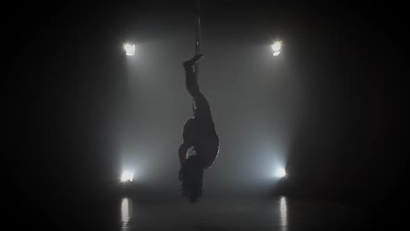 Thumbnail for Aerial Acrobat in the Ring. A Young Girl Performs the Acrobatic Elements in the Air Ring 003