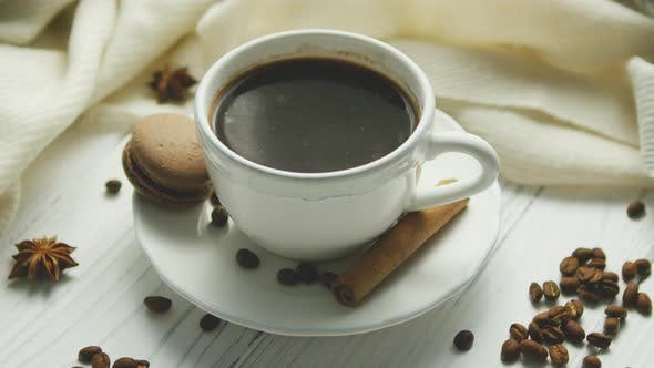 Cover Image for Cup of Coffee with Spices and Macaron