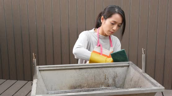 Cleaning of barbecue oven at outdoor