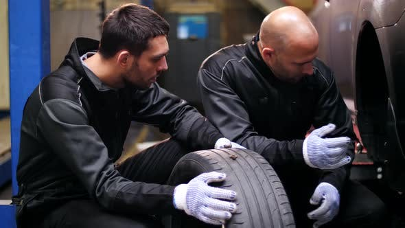 Thumbnail for Auto Mechanics Repairing Car Tire with Blowout