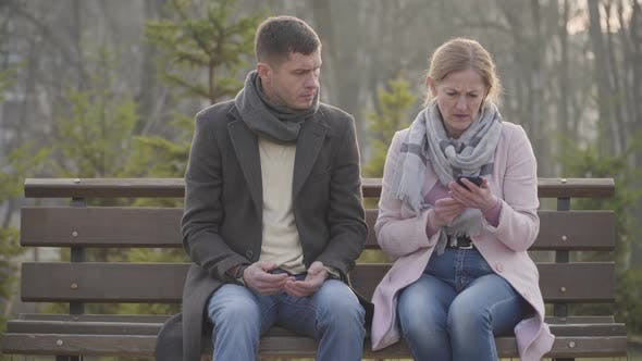 Thumbnail for Portrait of Displeased Adult Caucasian Woman Leaving Sad Young Man After Watching His Messages in