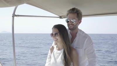 Medium Shot Slow Motion Happy Couple Steering Catamaran Yacht