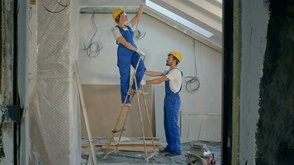 Thumbnail for Construction Worker Wearing Worker with Tools Renovating Apartment House