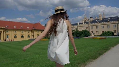 Tourist Woman is Running on Area of Lednice Castle