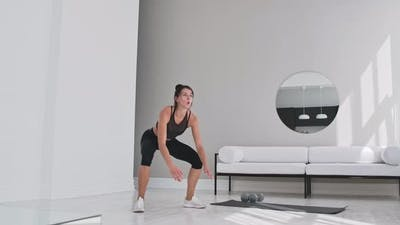 Fitness Woman Doing Burpee Workout at Home