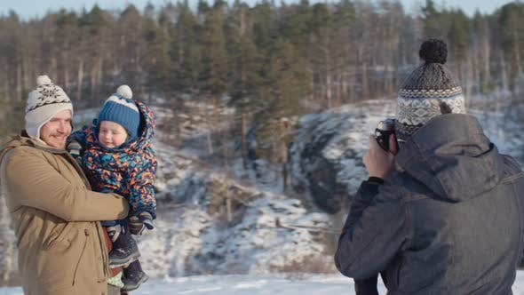 Thumbnail for Woman Taking Picture of Husband and Son