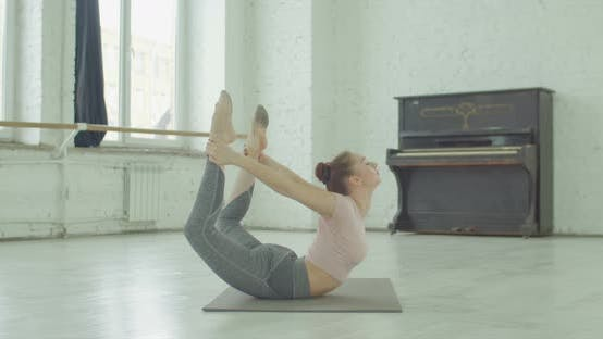 Thumbnail for Flexible Yogi Woman Stretching in Bow Pose Exercise