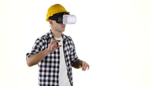 Engineer in Yellow Helmet Works with Help of Vr Glasses