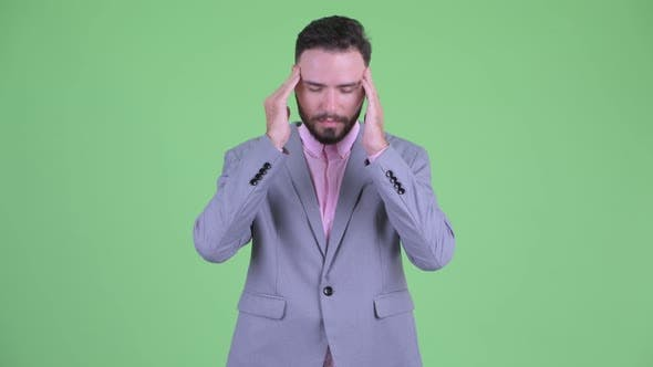 Thumbnail for Stressed Young Bearded Businessman Having Headache