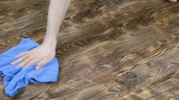 Thumbnail for A Man Washes the Floor Cloth. Male Hand Wipes the Laminate, the Men's Housekeeping