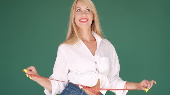Thumbnail for Pretty Blond Woman with Measuring Tape Around Waist