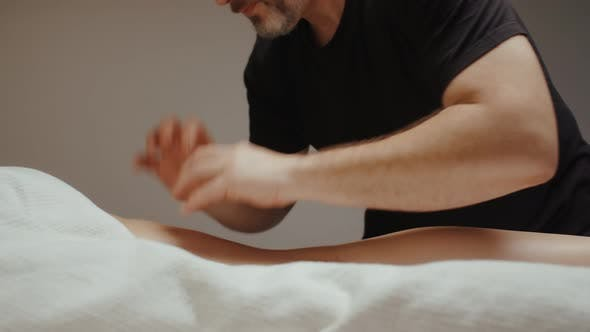 Thumbnail for Chiropractor Doing Leg Hip Anti Cellulite Massage. Slim Young Woman Receiving Health Procedure