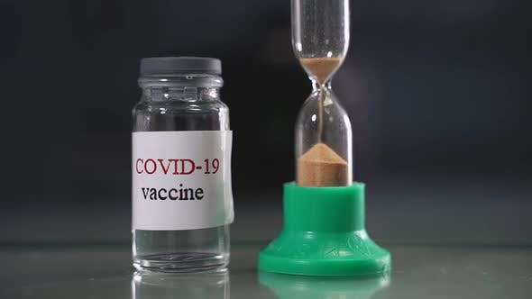 Vaccine Vial and the Concept of an Hourglass It's Time for Vaccination Vaccination Treatment for the